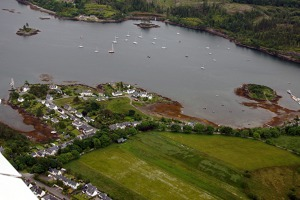 Plockton town and bay. The area is kept warme by the Gulf of Mexico