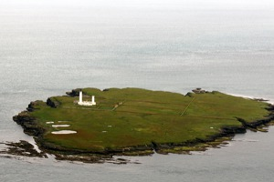 Pentland Skerries island with lighthouse - between Scottish mainland and Orkney islands