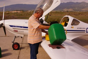 General Jorgos helping out pumping fuel from the tanks into the aircraft